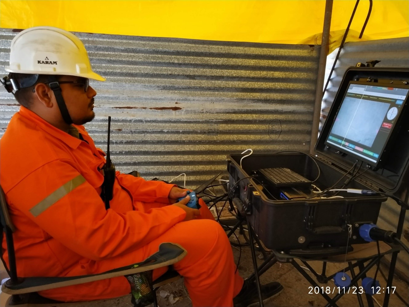(ROV Pilot controlling the underwater drone during inspection)